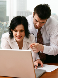 Entity Selection - Business man and business woman working on computer