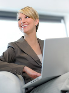Excluded Income - Image of Business Woman and computer