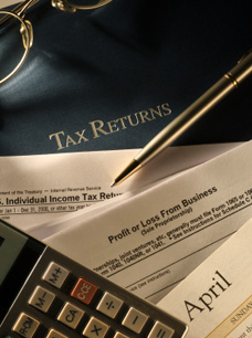 International Tax Returns - image of Calculator and files