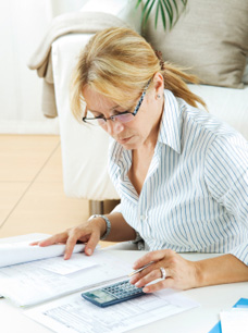 individual Tax Preparation - Image of Woman working on taxes