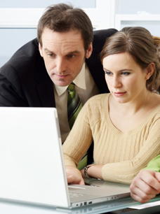 Using a Limited Liability Company LLC - Man and Woman working at a computer